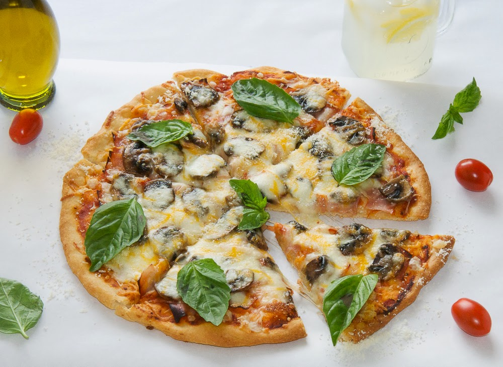homemade-pizza-recipe-with-mushrooms-mozzarella-basil