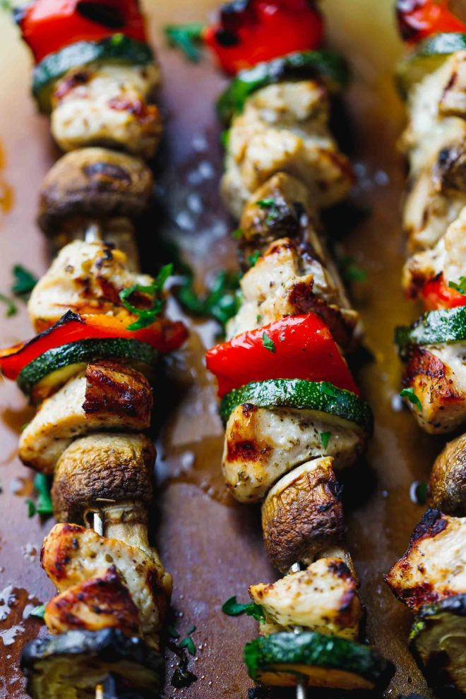 Grilled chicken kabobs with vegetables on a tray