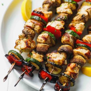 grilled Chicken Kabobs With Mushrooms, Zucchini And Peppers on a plate