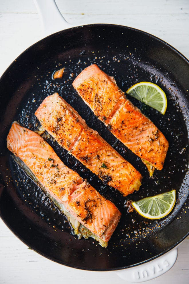 Pan seared salmon fillets in askillet