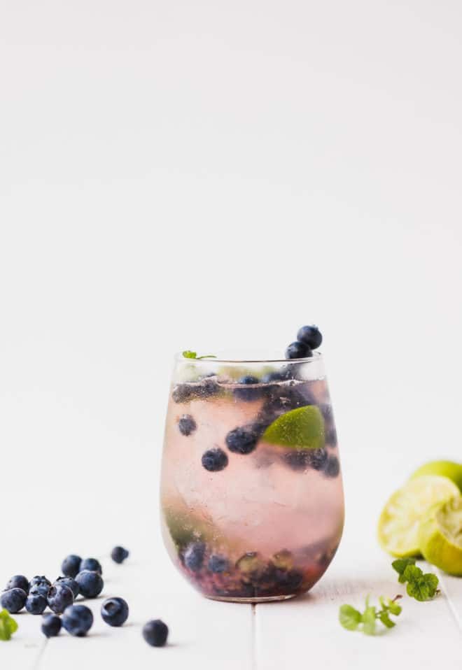 Blueberry mojito un a clear glass