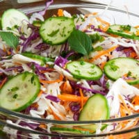 Red and green cabbage salad in a clear bowl