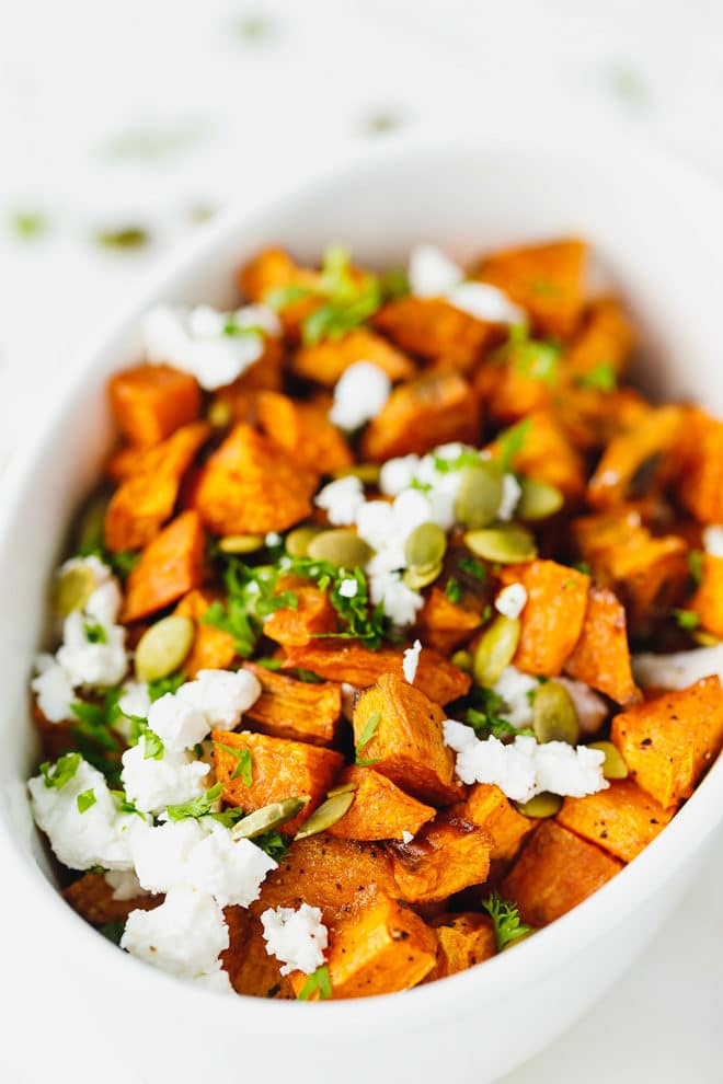 Roasted sweet potatoes in a white ceramic bowl