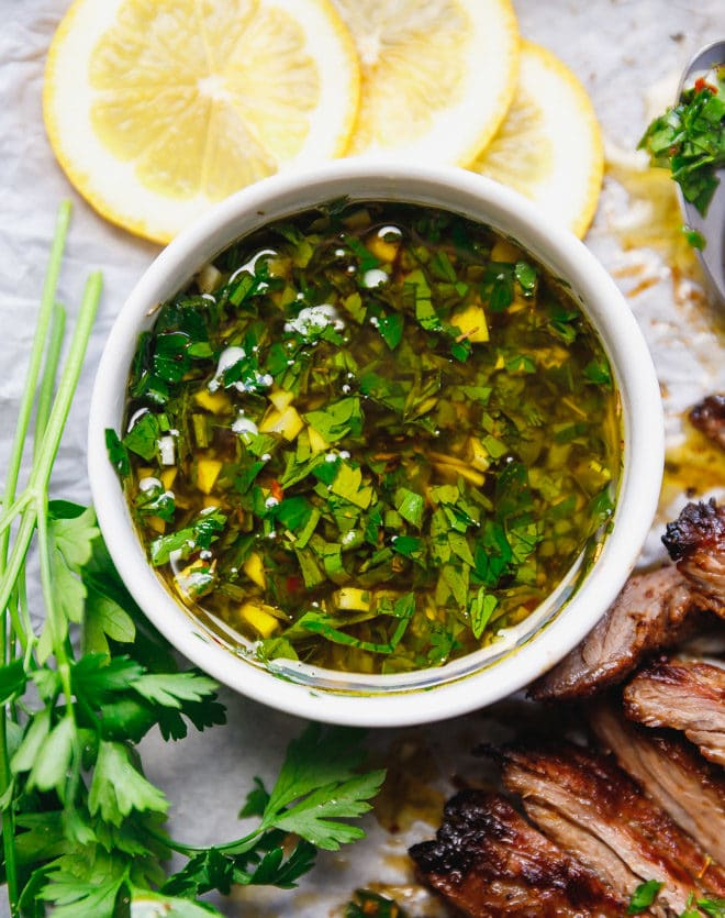 Chimichurri sauce in a white bowl