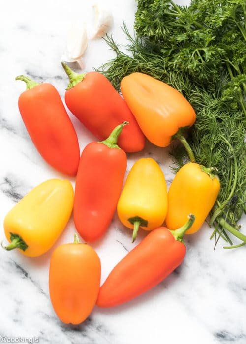 Red, orange and yellow sween mini peppers, perfect for a summer appetizer. Serve with parsley, dill, garlic, salt, oil and vinegar.