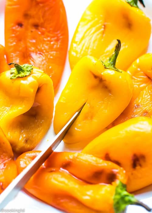 Bulgarian grilled or roasted sweet peppers with oil, vinegar, parsley, dill and garlic. Great for a salad aor an appetizer