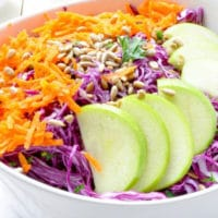 Purple Cabbage and Green Apple Salad in a white ceramic bowl
