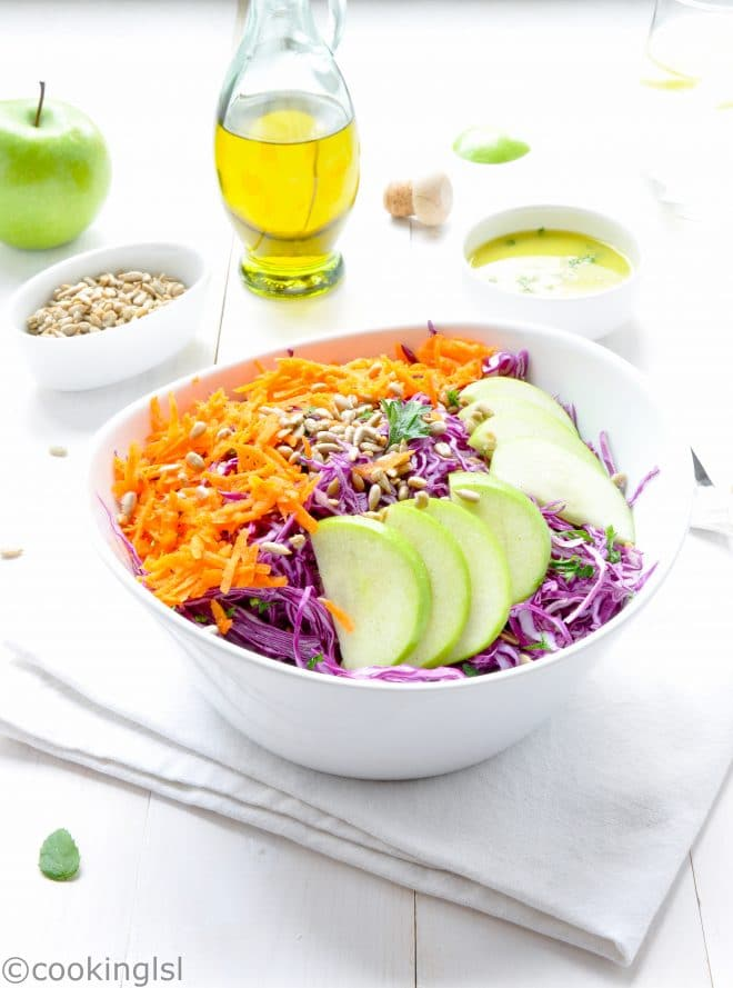 Salad made with antioxidant rich purple cabbage, sliced Granny Smith Green Apple, carrots and sunflower seeds