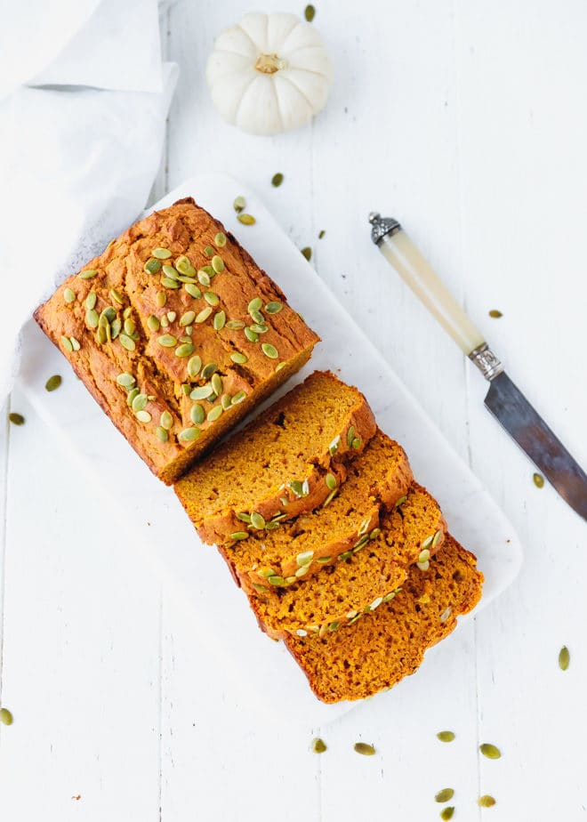 Sweet and moist pumpkin bread on a cutting board