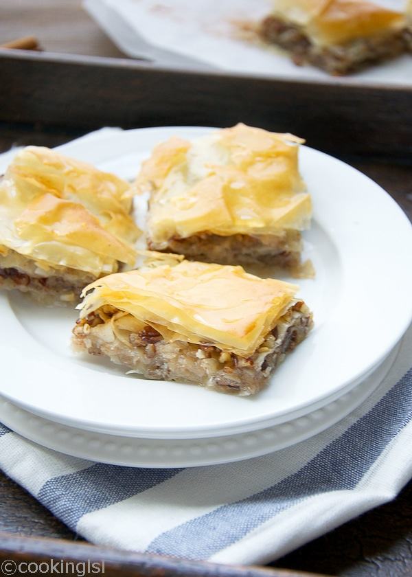 Coconut Pecan Baklava - Layers of Phyllo dough, sandwiched with coconut-pecan filling, sweetened and held together with vanilla flavored-lemon syrup. Buttery, sweet and nutty.