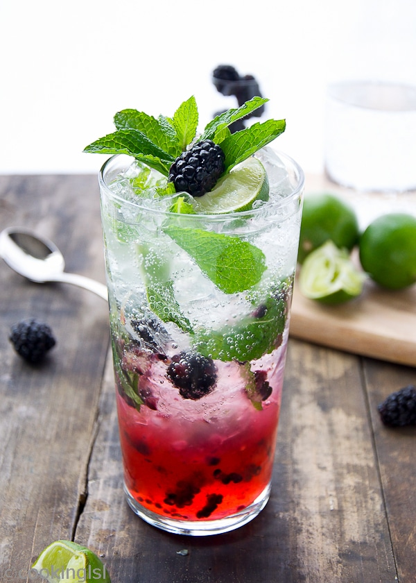 Blackberry Mojito Cocktail in a class topped with mint