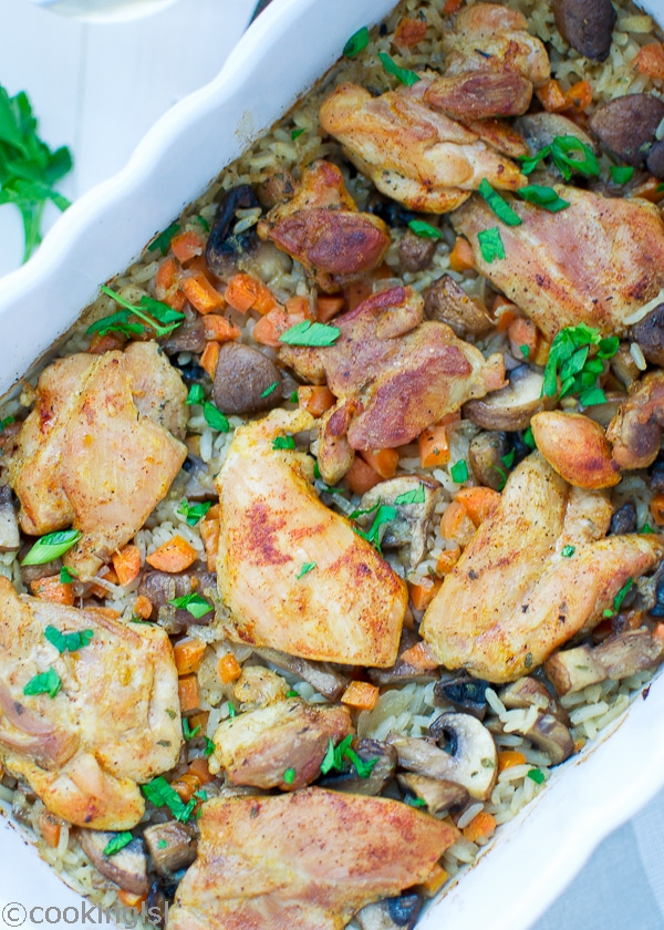 One Pot Chicken And Rice - chicken thighs over rice and mushrooms. Easy, tasty and nutritious, I can probably eat it every day! Well, I don't get to make it every day, but I'm glad I did today! #chickenrecipes #onepotrecipes #chickenandrice