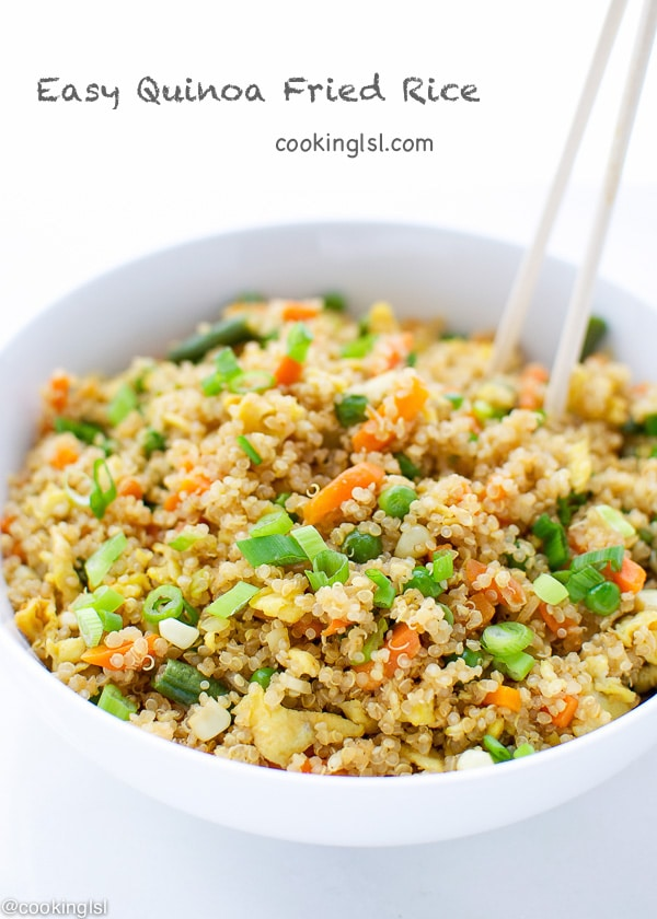 EASY QUINOA FRIED RICE in a white bowl with chopsticks on the side, colorful and chunky dish.