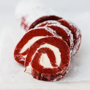 Red velvet cake roll on parchment paper