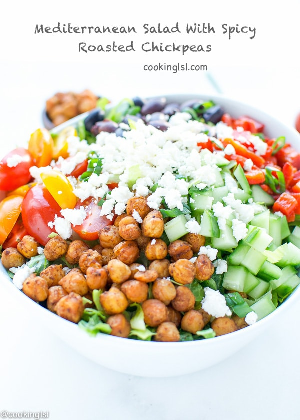 Mediterranean style lettuce salad made with cherry tomatoes, cucumbers, roasted red peppers, Kalamata Olives, Feta and crunchy roasted chickpeas