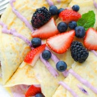 berry cheesecake crepes on a plate