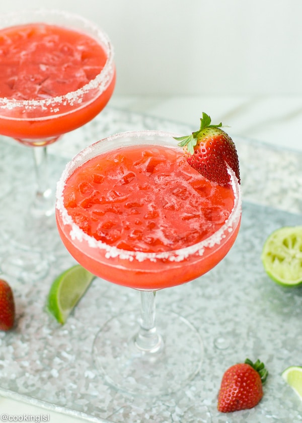 Easy Fresh Strawberry Margarita Cocktail great for summer parties and gathering. Make it for Cinco De Mayo