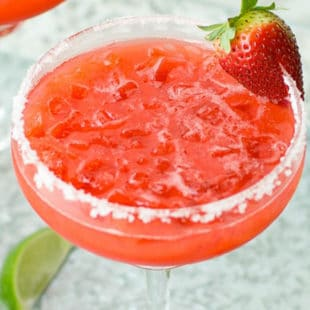 Strawberry margarita in a margarita glass with salt