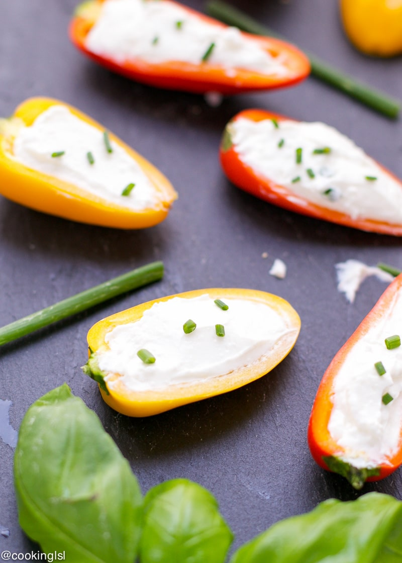 whipped feta stuffed mini peppers on a cheese board