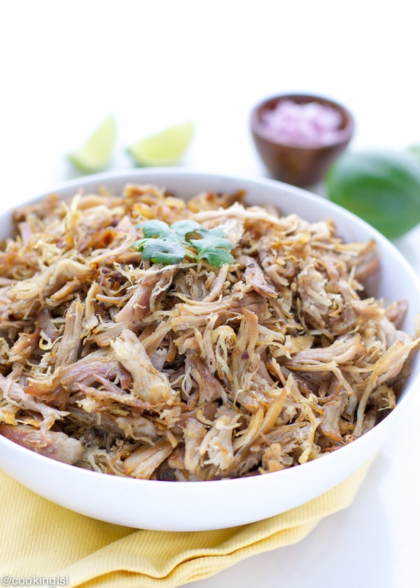 Easy slow cooker pulled pork carnitas in a large white bowl.