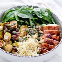 Balsamic Brussels Sprouts And Chicken Spinach Quinoa Bowls - in a ceramic bowl, with quinoa