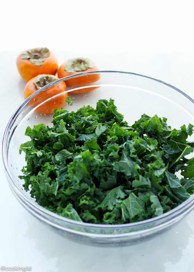 A bowl of chopped kale to be massaged and made tender for a kale persimmon salad, great for winter!