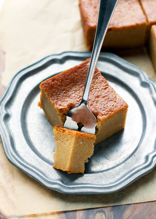A slice of pumpkin magic custard cake on a plate