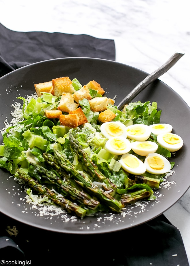 Crisp romaine lettuce tossed in homemade Caesar dressing, crunchy croutons, charred asparagus and hard boiled quail eggs - a great spin on traditional Caesar salad.