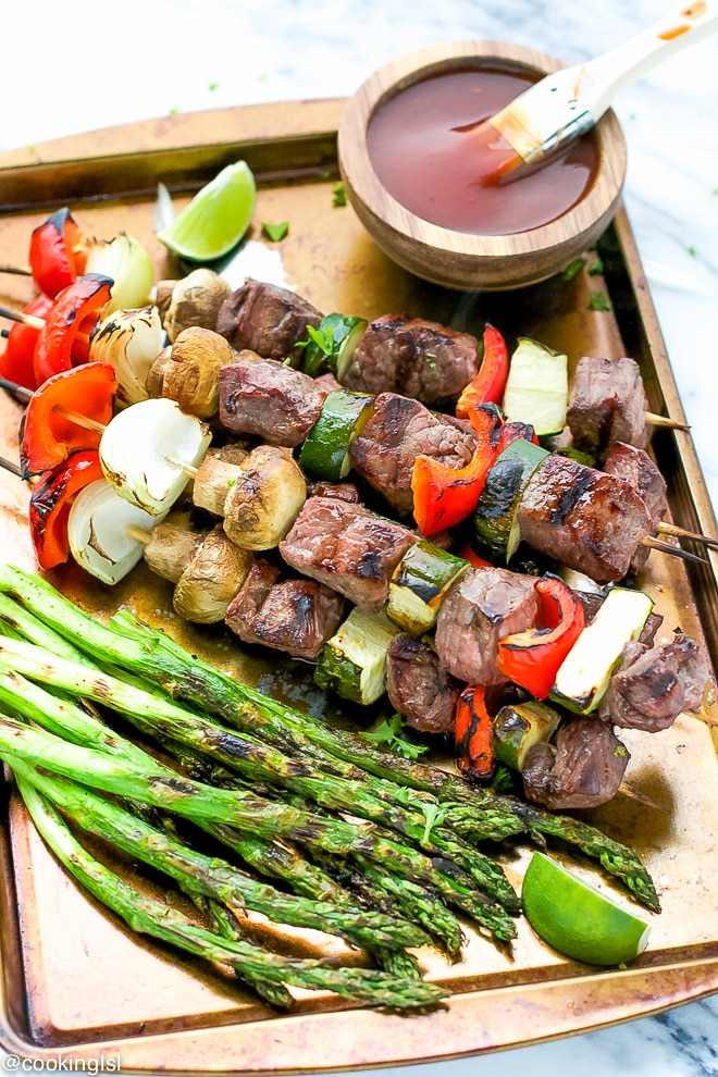 Tangy Carolina Heinz Barbecue sauce, brushed over grilled pieces of beef sirloin, skewered onto wooden skewers with mushrooms, zucchini, peppers and onion. The perfect beef kabobs.