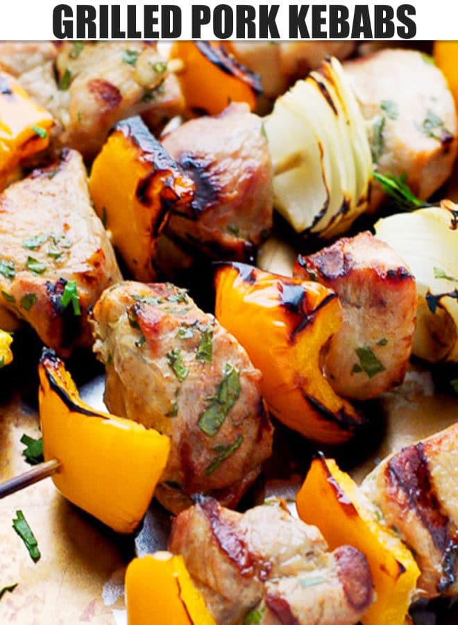 GRILLED PORK KEBABS WITH ONION AND PEPPER ON A BAKING TRAY