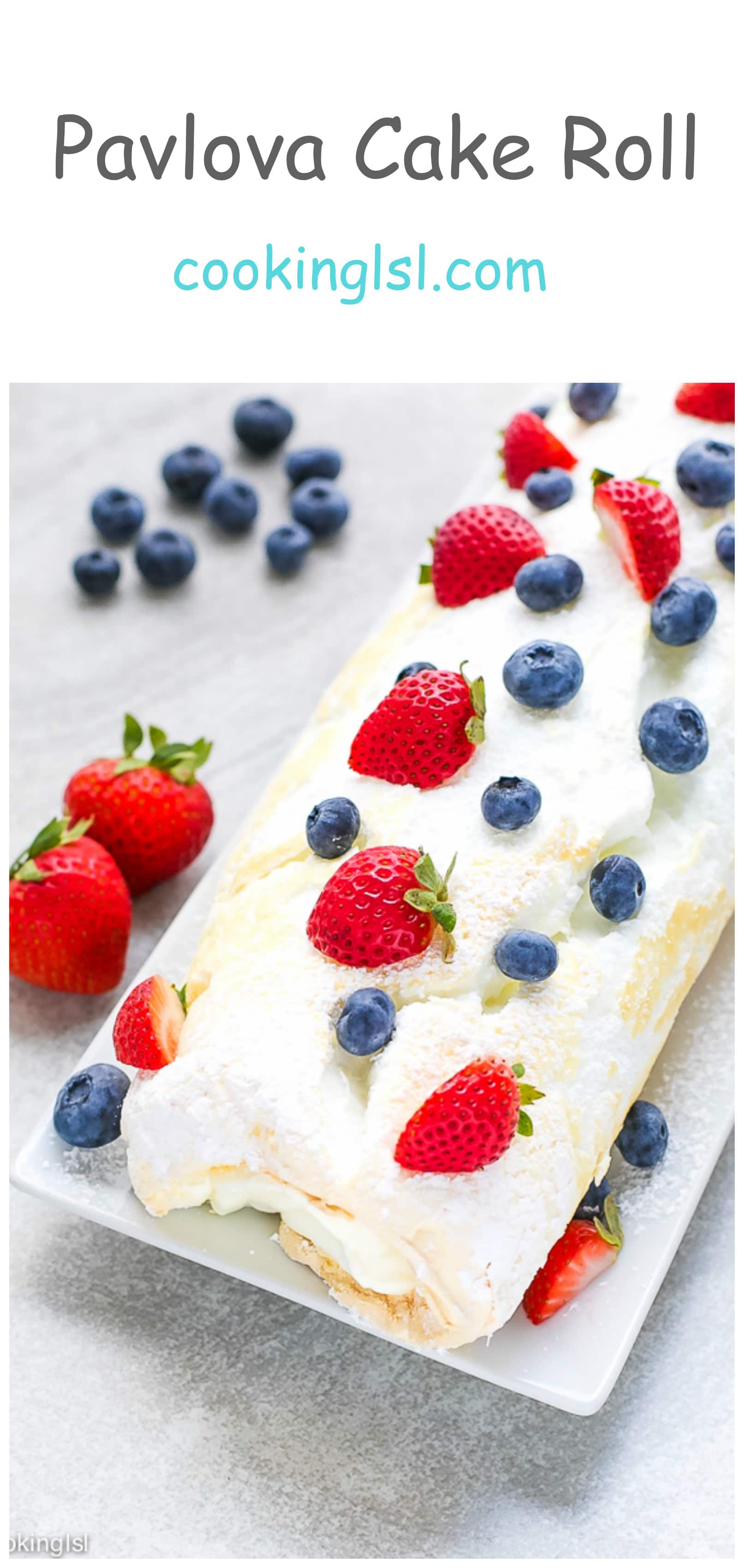 Pavlova Cake Roll Recipe - light and airy cake roll, filled with rich cheesecake whipped cream and topped with berries.
