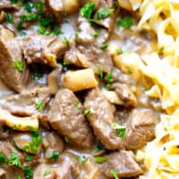 beef stroganoff in a pan with noodles