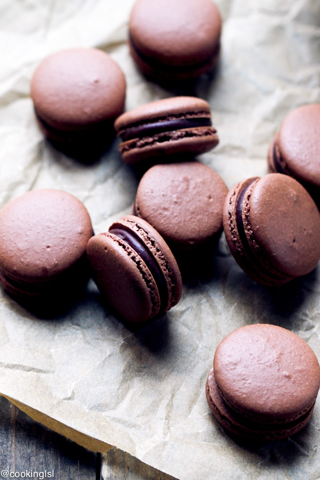 Homemade chocolate french macarons on parchment paper