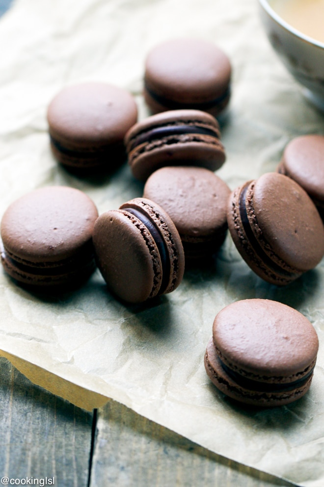 chocolate macarons on parchment paper