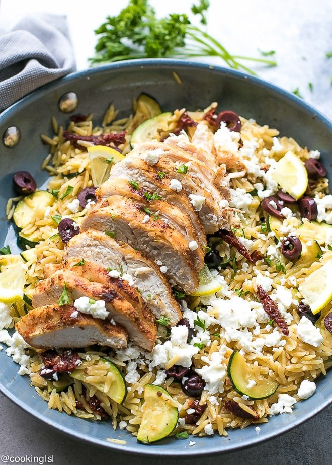 Orzo With Zucchini, Sun Dried Tomatoes and chicken, topped with feta and olives
