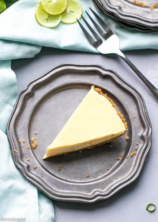 Light, lower calorie key lime pie recipe. A slice of Key Lime Pie, on a metal plate, with lime zest on top.
