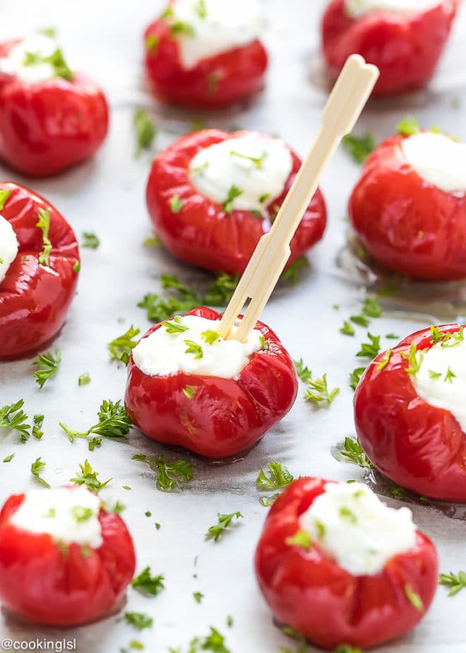 Cream Cheese And Feta Stuffed Cherry Peppers Appetizer Topped with parsley with a wooden toothpick for a summer party.