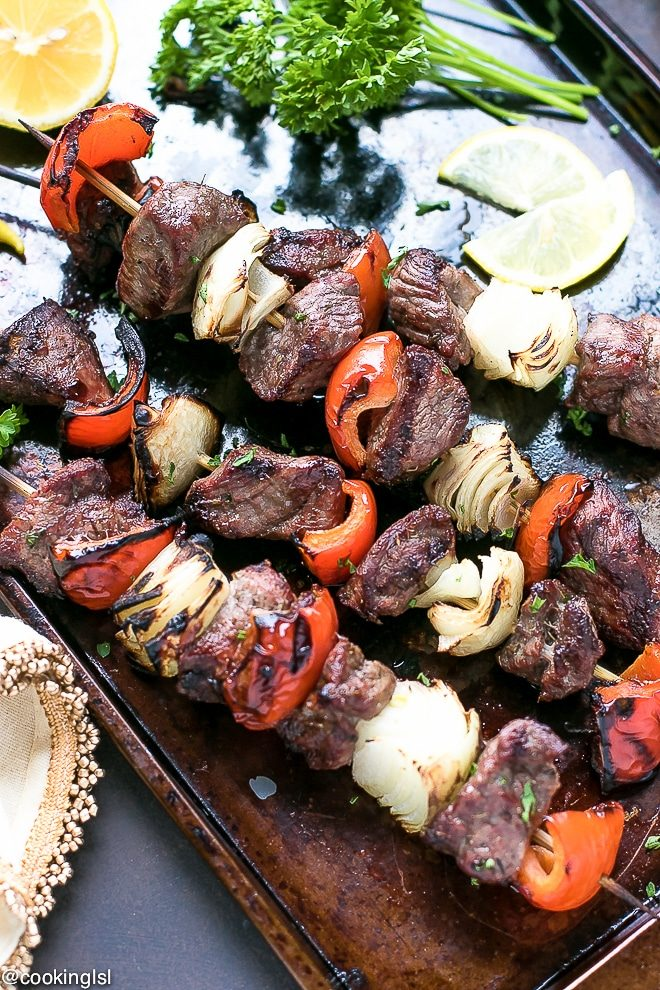 Easy Marinated Grilled Greek Lamb kebabs. Bulgarian/Mediterranean style seasoning, tender pieces of marinated leg of lamb on skewers with vegetables and grilled to perfection.