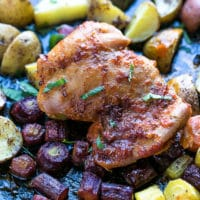 sheet pan harissa chicken potatoes carrots on a large baking sheet