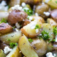 Grilled Greek Potatoes In Foil. Seasoned with oregano, garlic, lemon juice and topped with crumbled feta.