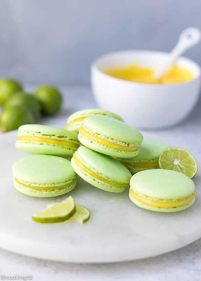 Stack of lime macarons, light green French macarons, filled with lim e curd. Tangy and sweet macarons.