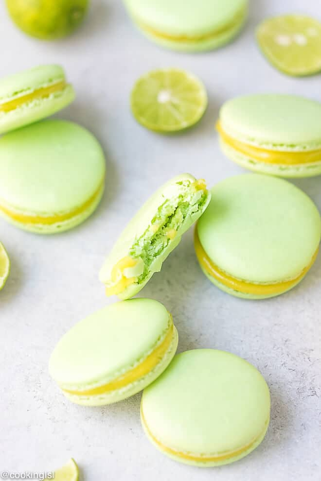 No hollow macarons. Chewy macarons, bite into soft macarons. Key lime macarons recipe with lime curd.