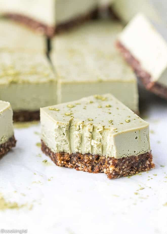 Chunky Bite of Vegan, Raw , clean Matcha Cheesecake Bars, made with coconut cream, Agave nectar, coconut oil, matcha powder and cashews