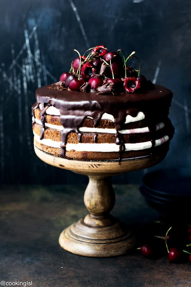Gorgeous, festive, very easy to make, non authentic easy black forrest cake recipe. Black Forest cake on an acacia cake stand.