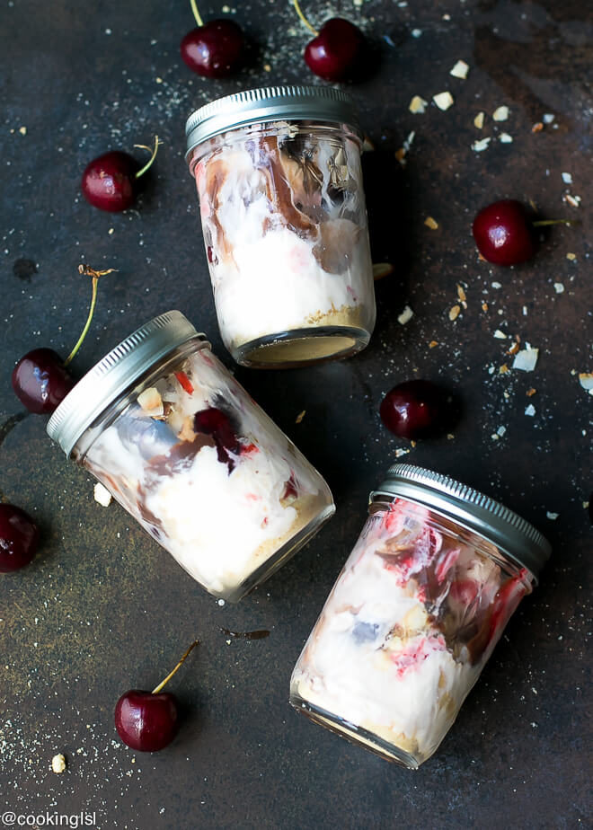 Cherry Sundae Recipe - Blue Bunny® Cherrific Cherry Cheesecake ice cream, in small glass jars with lids, perfect for make ahead snack. With fresh ripe cherries on the side.