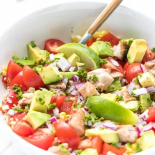 Grilled Chicken Quinoa Corn Salad Recipe - a white porcelain salad bowl, full with nutritious summer salad, colorful, easy to make, grilled chicken and corn, combined with quinoa, fresh tomatoes and avocado.