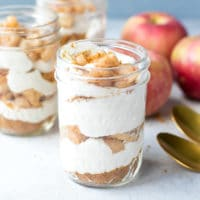Healthy No Bake Apple Pie Cheesecake In A Jar Recipe. Ball Jars, filled with healthy yogurt cream cheese cheesecake, with cinnamon apple topping on top.