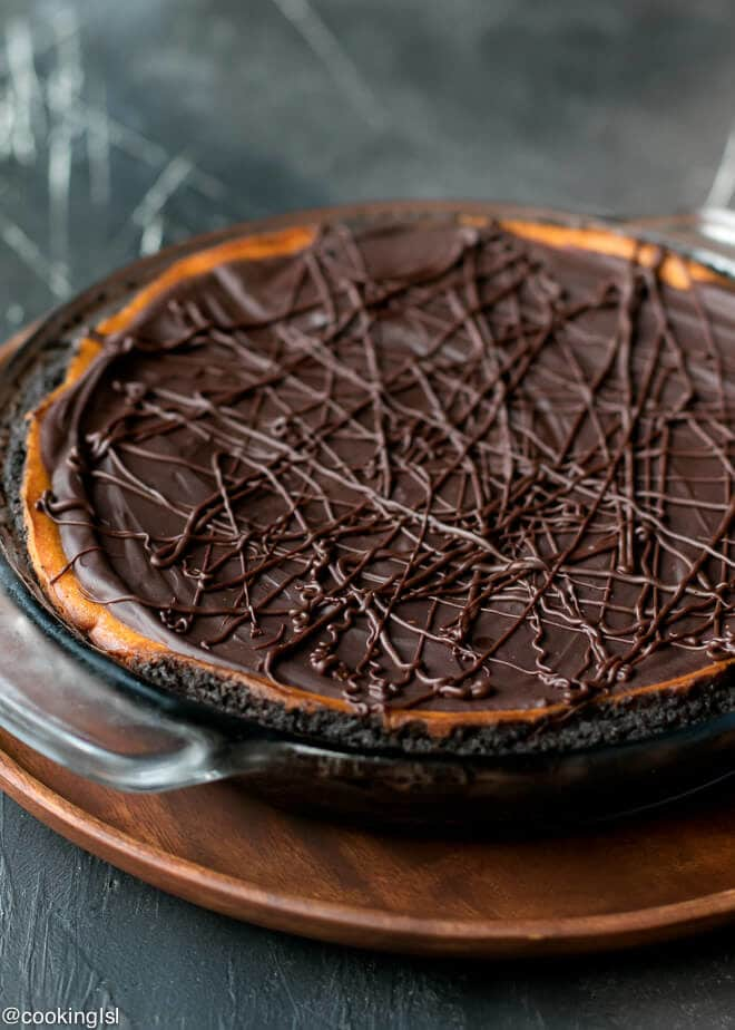 Dark Chocolate Pumpkin Pie With Chocolate Crust Recipe. A glass pie dish with pumpkin chocolate pie in it.