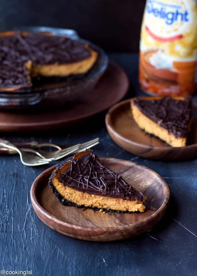 A slice of pumpkin chocolate pie on a plate for Thanksgiving. Dark Chocolate Pumpkin Pie With Chocolate Crust Recipe