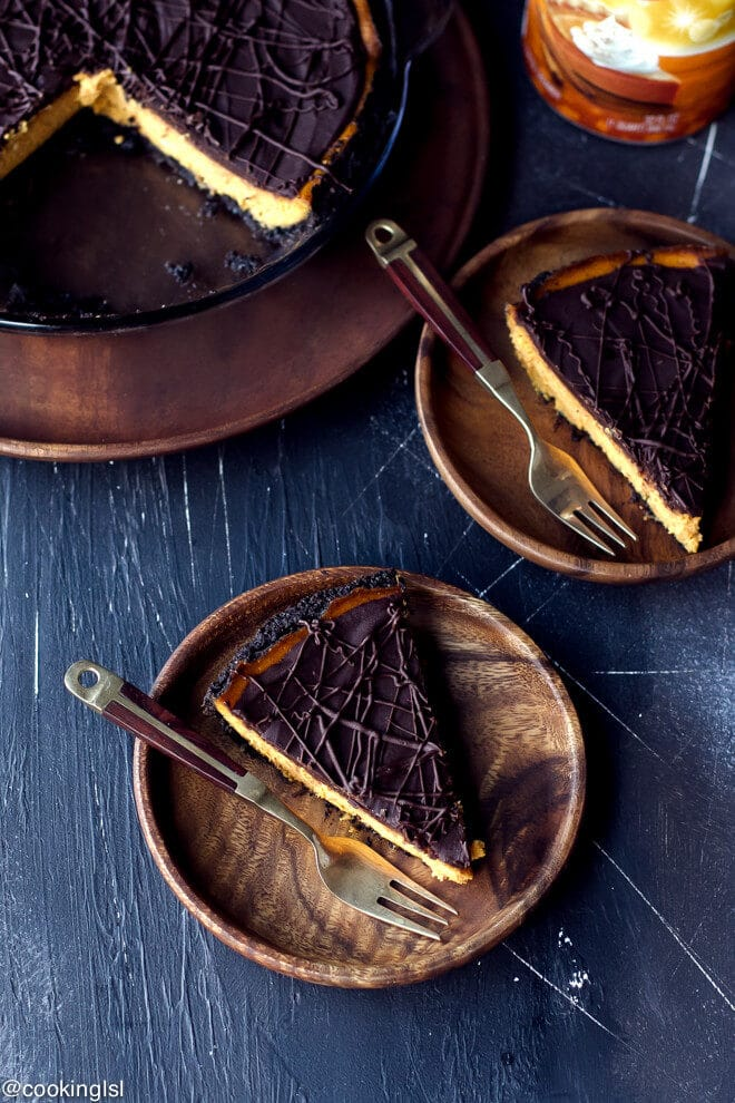 Slices of creamy low fat dark chocolate pumpkin pie. Dark Chocolate Pumpkin Pie With Chocolate Crust Recipe. Made with International Delight® Coffee creamer. Great for Thanksgiving.
